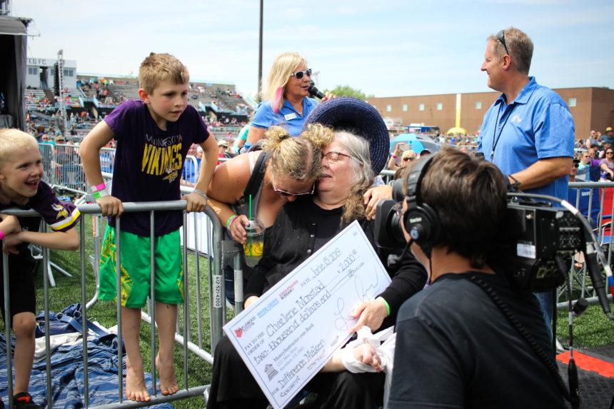 Charlene Morstad receiving check